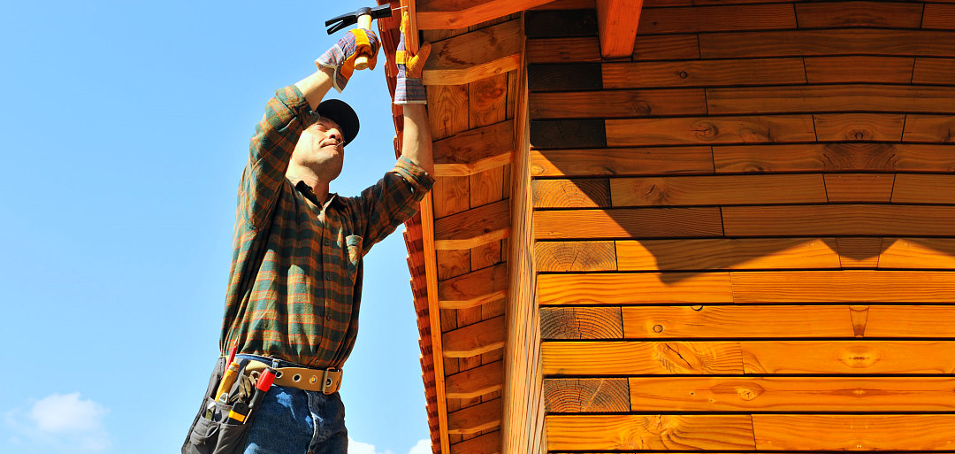 man fixing the house roof